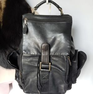 Vintage black backpack leather pockets soft